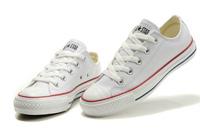 6 รองเท้าผ้าใบ สีขาว
